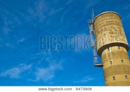 Watertower Against a Blue Sky