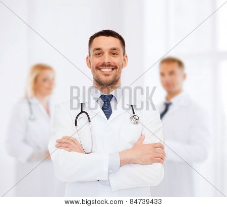 healthcare, profession and medicine concept - smiling male doctor with stethoscope in white coat over white background