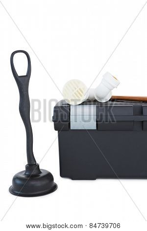 Plunger and toolbox on white background