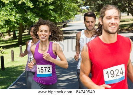 Fit people running race in park on a sunny day