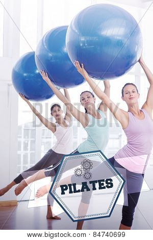 The word pilates and fitness class doing pilates exercise with fitness balls against hexagon
