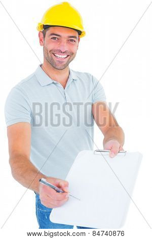 Portrait of smiling manual worker giving clipboard for signature against white background