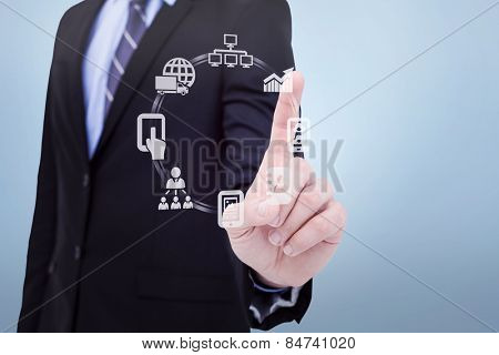 Mid section of businessman pointing something up against grey vignette