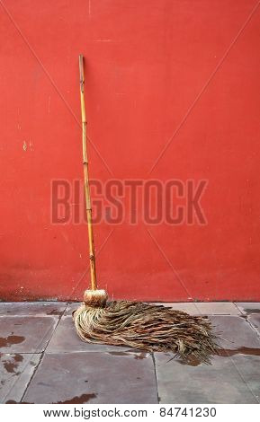 Mop Lean Against Red Wall