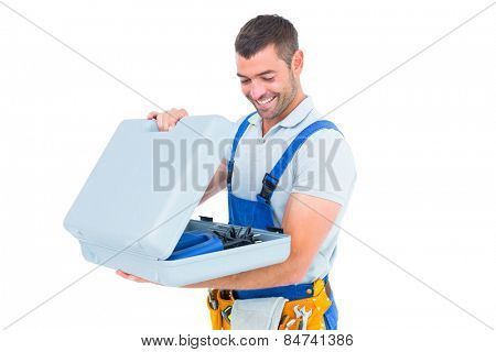 Happy repairman opening toolbox on white background