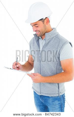 Smiling manual worker writing on clipboard on white background