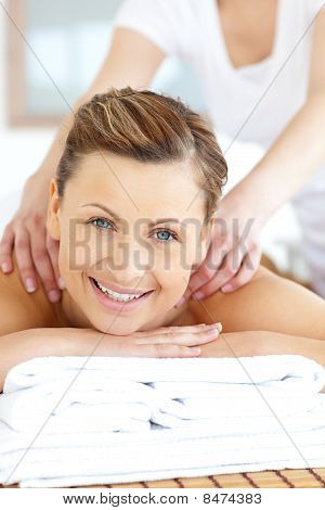 Cheerful Young Woman Having A Back Massage