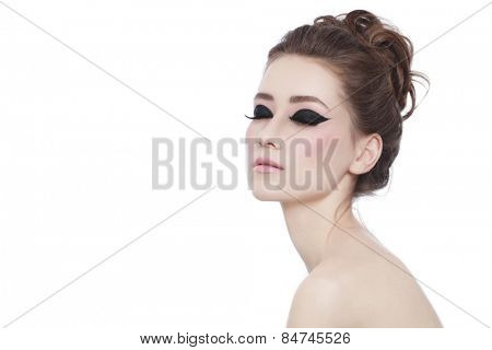 Young beautiful slim woman with fancy cat eye make-up and stylish hairdo over white background