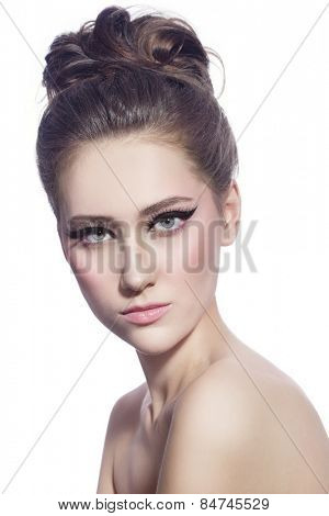 Young beautiful woman with fancy cat eye make-up and stylish hairdo over white background