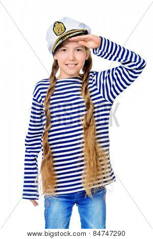 Joyful teen girl wearing sailor's striped vest and marine cap. Studio shot. Isolated over white.
