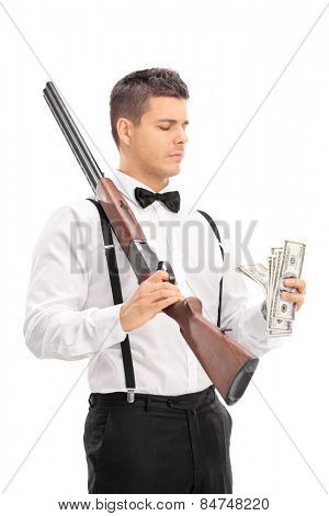 Man with shotgun counting money isolated on white background