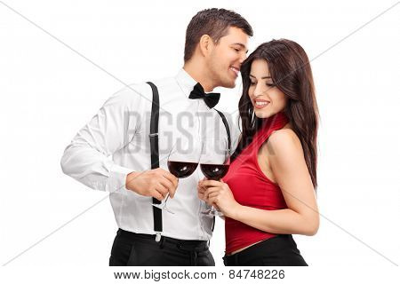 Young man whispering something to a woman isolated on white background