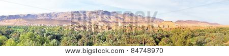 Panorama from a village in  the Moroccan mountains in Morocco on the thousand Kasbah road. Oasis in Sahara desert area