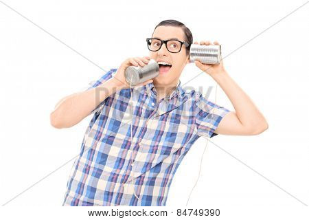 Silly man talking to himself through tin can phone isolated on white background