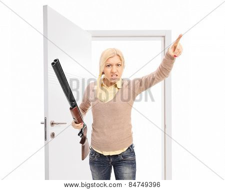 Angry woman with rifle threatening someone isolated on white background