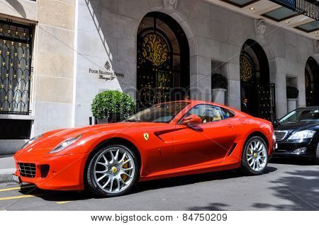 PARIS, FRANCE - CIRCA JULY 2009: A Ferrari 599 GTB Fiorano parked in front of the George V Hotel in Paris