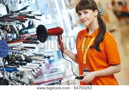 Positive shop assistant in home electric appliance supermarket store