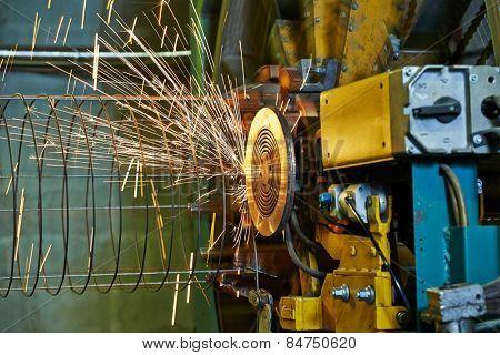 Spot welding machine. Concrete tube reinforcement production at factory