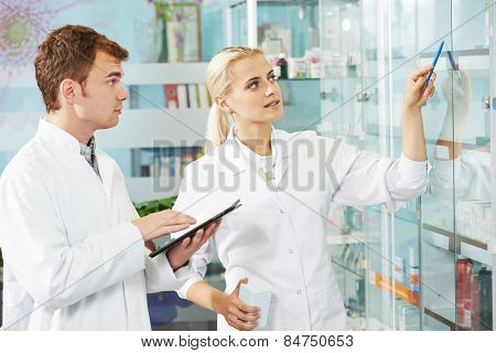 cheerful male pharmacist chemist man portrait in pharmacy drugstore