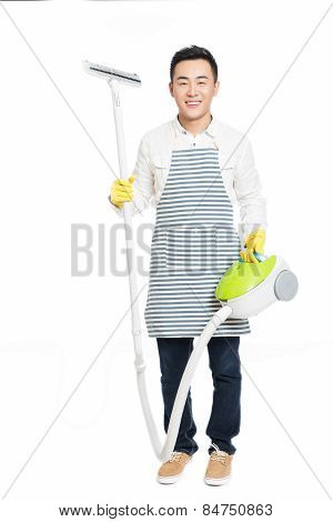 Young Man Uses Vacuum Cleaner
