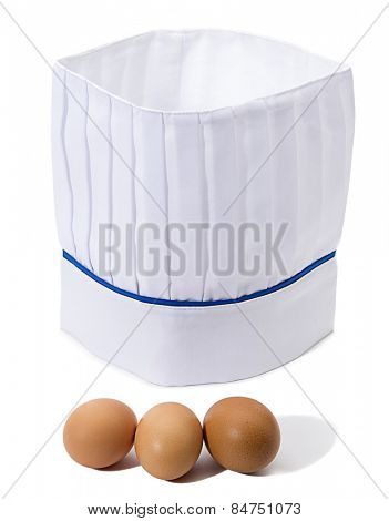 Eggs with chef's hat isolated on white background.
