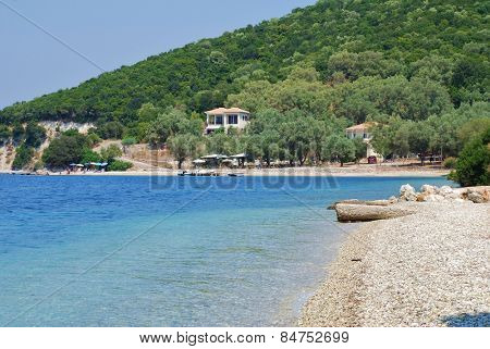 MEGANISSI, GREECE - AUGUST 24, 2008: The shingle beach at Agios Ioannis on the Greek island of Meganissi. With a population of around 2000, the Ionian island is a satellite of larger Lefkada island.