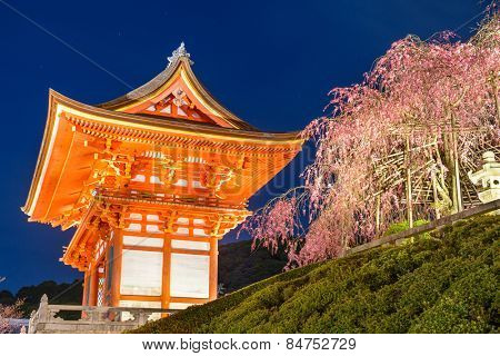 Kyoto, Japan at Kiyomizu-dera Shrine outter gate in the Spring illuminated at night.