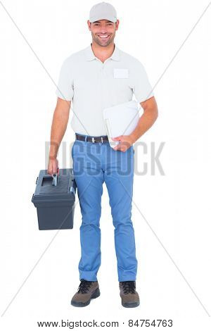 Full length portrait of confident male technician with toolbox and clipboard on white background