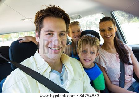 Happy family on a road trip on a sunny day