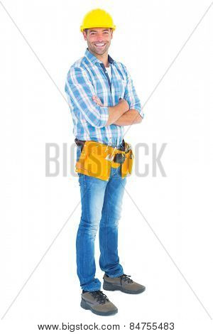 Portrait of manual worker standing arms crossed on white background