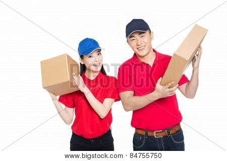 Young Man And Woman Carrying Cardboard Box
