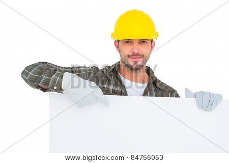 Handyman holding and pointing at blank board on white background