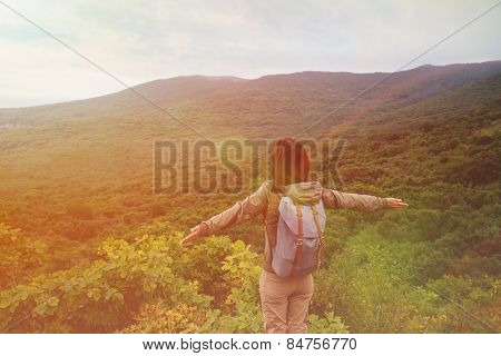 Traveler Woman Standing With Raised Arms On Mountain