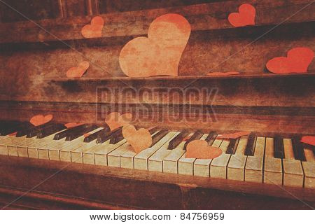Piano with red paper hearts