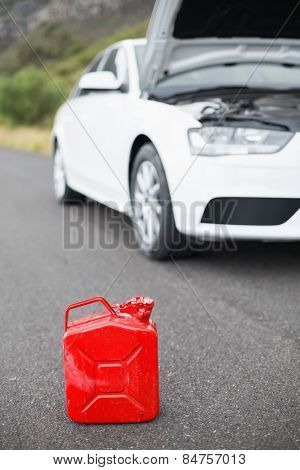 A petrolcan next to car after a breakdown at the side of the road