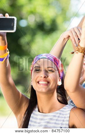 Excited music fan at festival on a summers day