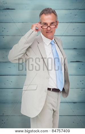 Thinking businessman against wooden planks