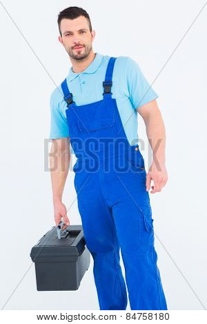 Repairman with toolbox on white background