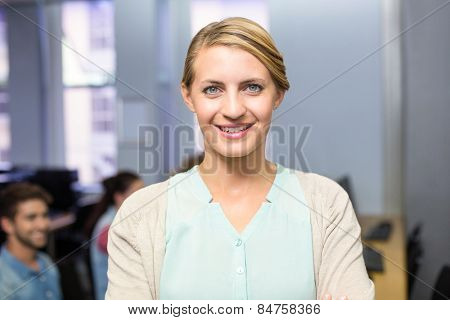 Close up portrait of confident female teacher smiling