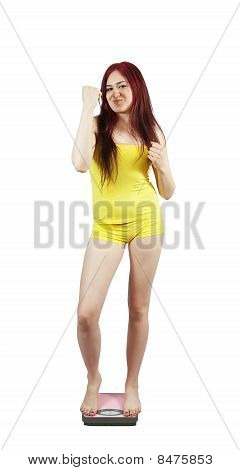 Girl Standing On Bathroom Scales