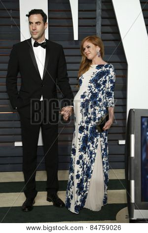LOS ANGELES - FEB 22:  Sacha Baron Cohen, Isla Fisher at the Vanity Fair Oscar Party 2015 at the Wallis Annenberg Center for the Performing Arts on February 22, 2015 in Beverly Hills, CA