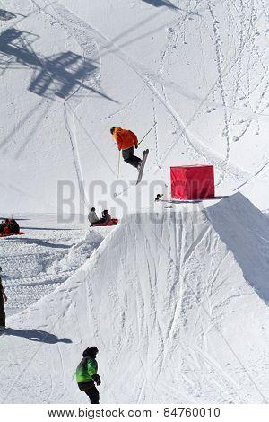 Skier jumps in Snow Park,  mountain ski resort