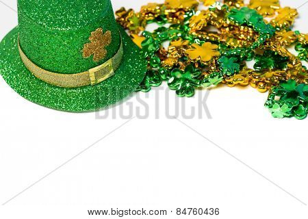 Saint Patrick's day decorations with a hat and beads on a white background