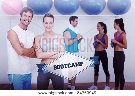 The word bootcamp and smiling couple with fitness class in background against badge