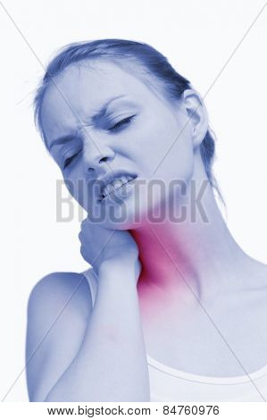 Young woman massaging her painful nape against white background