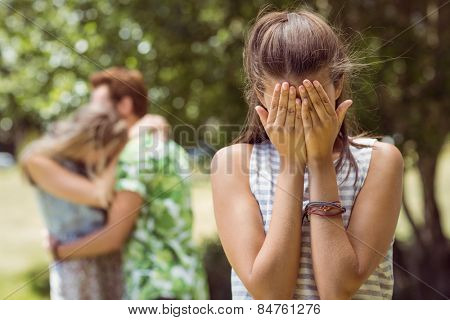 Brunette upset at seeing boyfriend with other girl on a summers day