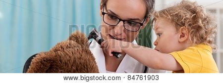 Little Boy Using Otoscope