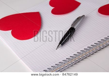 Note Book With Checked Pages, Pen And Paper Hearts