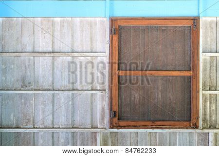 Old Window With Cage On White Wooden Wall
