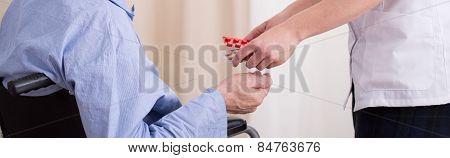 Nurse Giving Patient Medicament